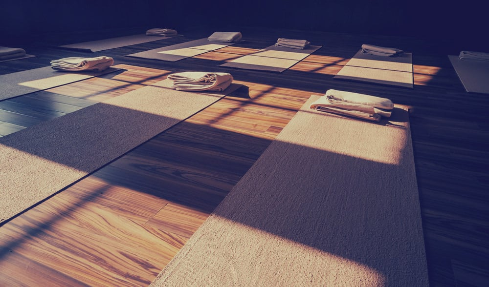 I like how this studio provides carpet yoga mats with towels.