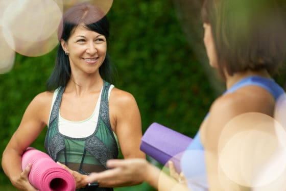 Yoga teacher giving good customer service