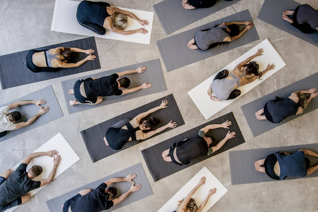 Aerial photo of a large yoga class.