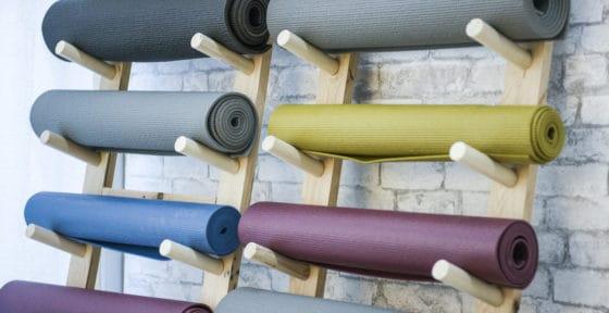yoga mats stored on yoga mat shelf