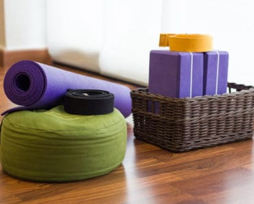 Yoga props - mat, pillow, blocks and strap in yoga studio