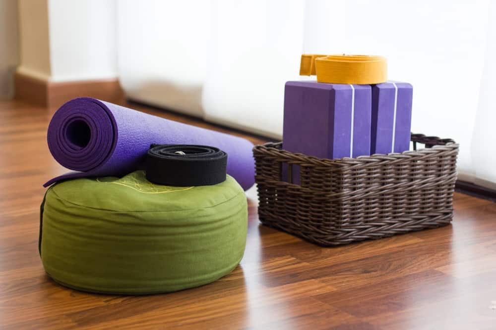 Yoga props - mat, pillow, blocks and strap in yoga studio