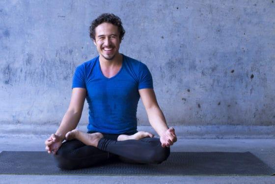 Yoga teacher at front of yoga class