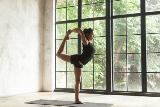 Yoga teacher practicing in her yoga studio