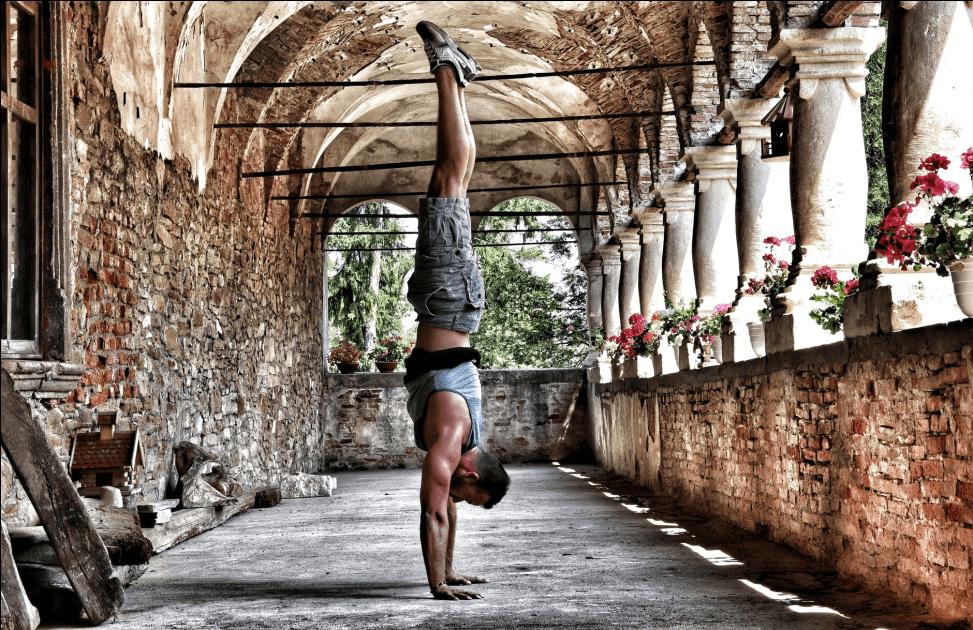 Man doing yoga alone