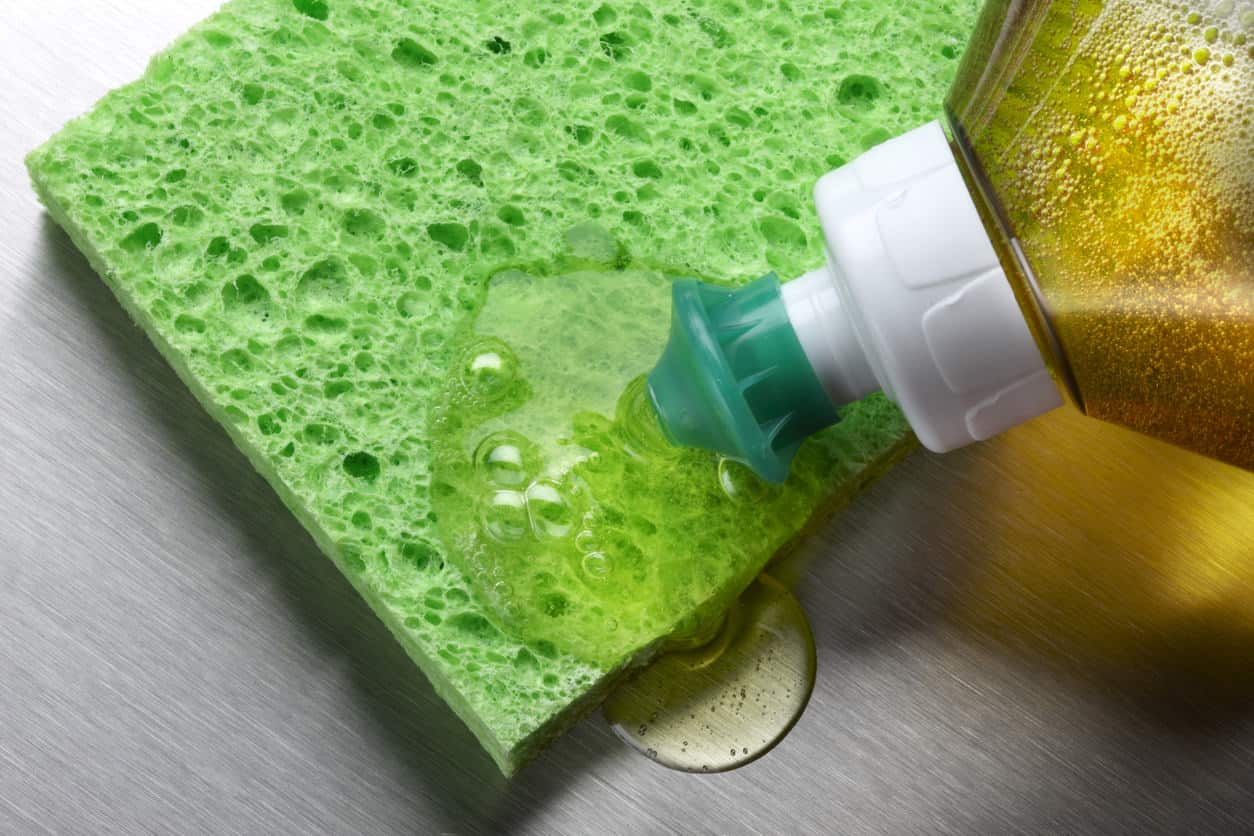 Sponge and dish soap for cleaning a yoga mat