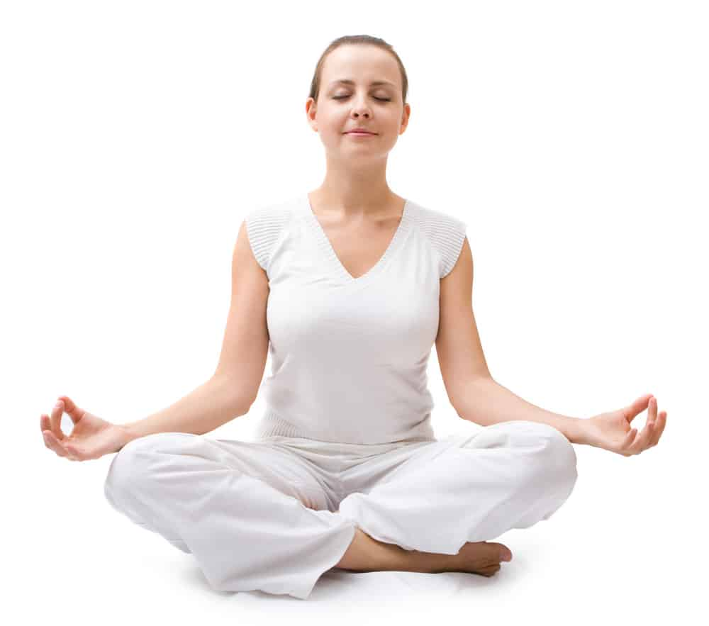 Girl meditating in white dress with white background around her