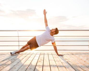 Man Doing Yoga on pier