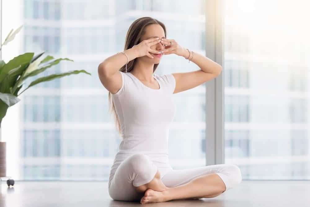 Young woman practices yoga in a studio