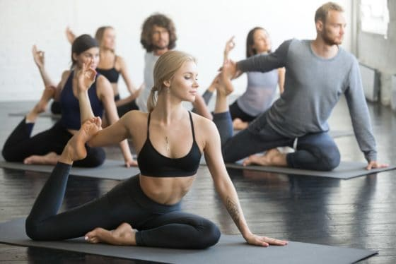Sporty Students taking Yoga Class