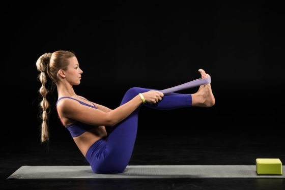 Woman Using a Yoga Strap