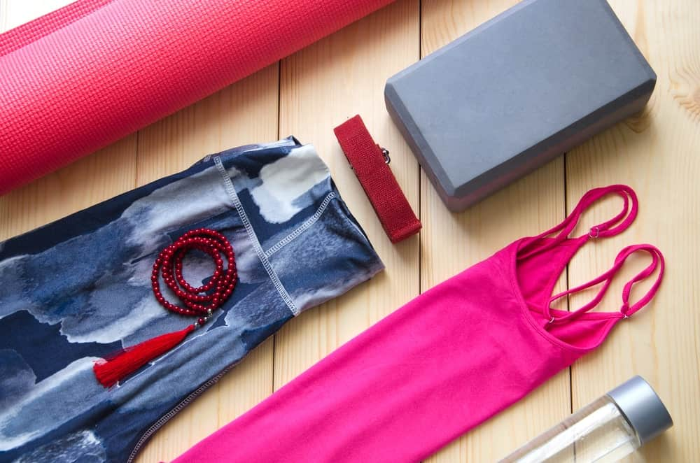 Various types of activewear and accessories for yoga.