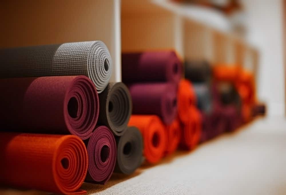 Red and orange rolled up yoga mats