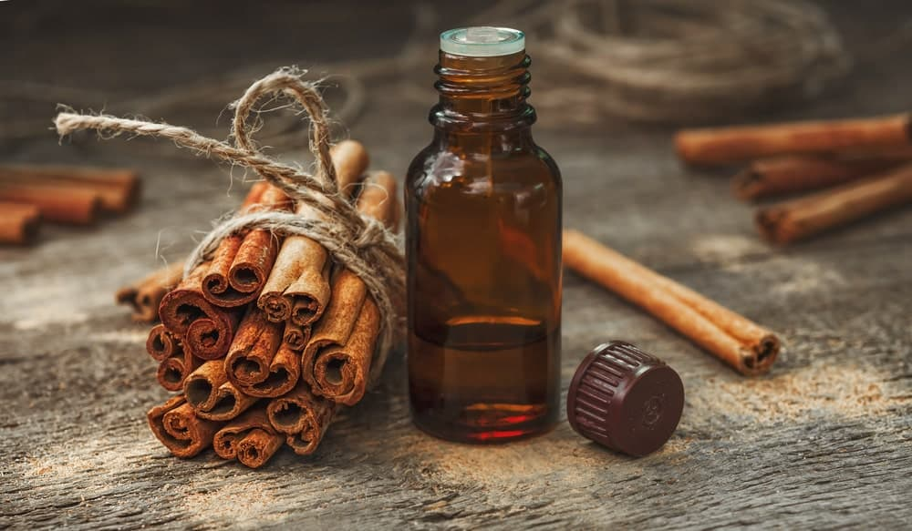 Cinnamons and a bottle of essential oil.