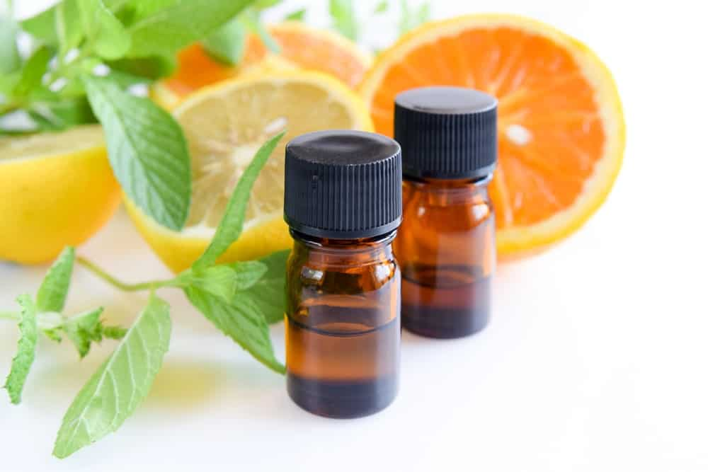 Oranges and bottles of essential oil.