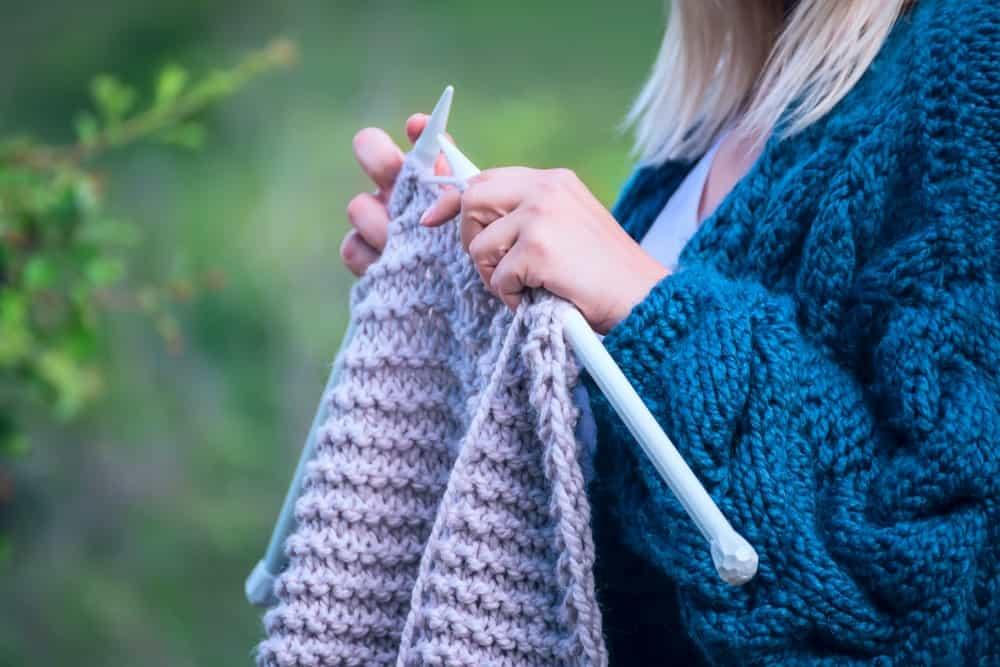 A Woman Knitting Alone