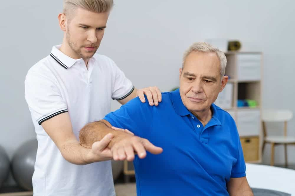 Geriatric physical therapy of a senior man