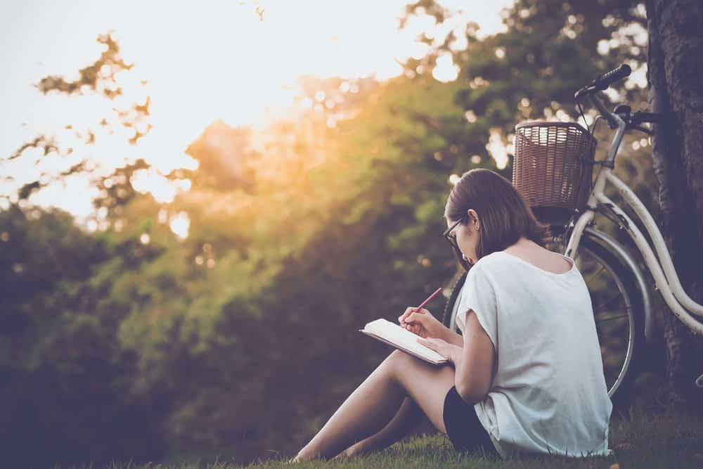 A Girl Writing In Her Journal