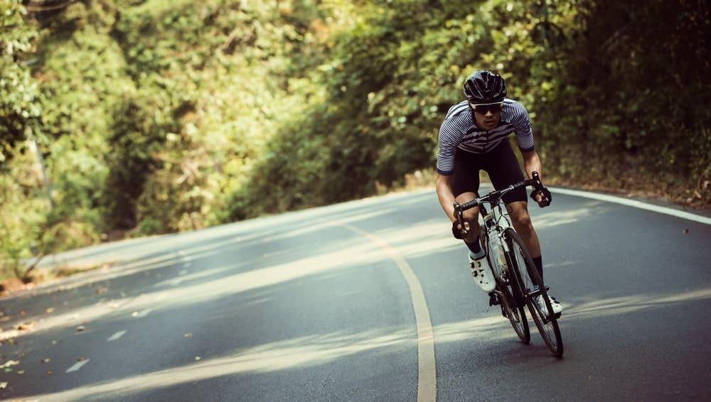 A Man Cycling Alone