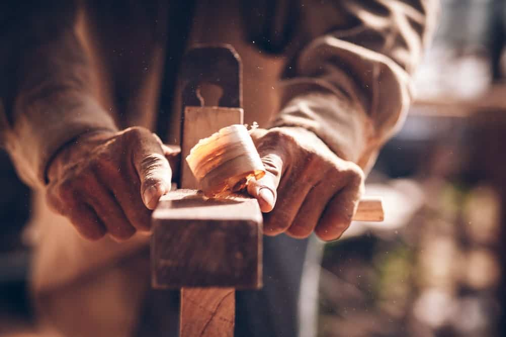 A Person Working With Wood