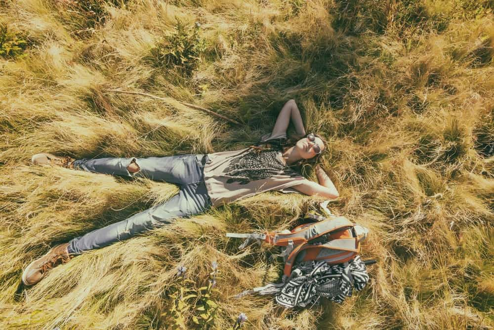 A Man Laying In Grass Alone
