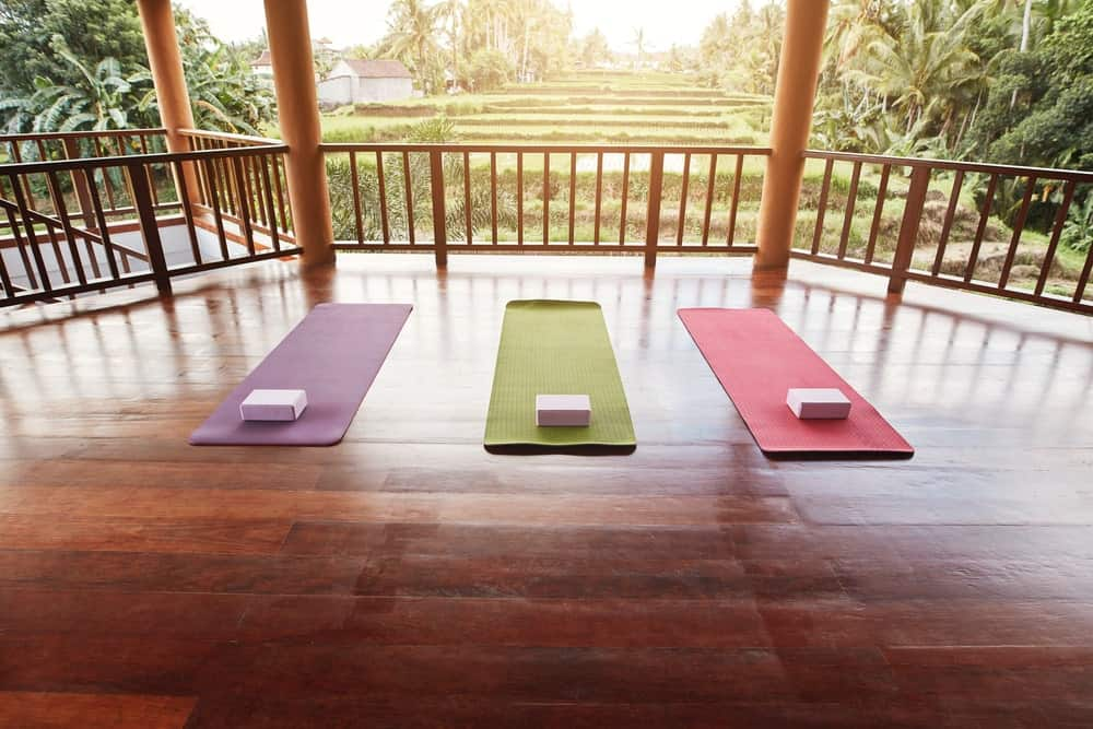 An open yoga studio with colorful mats and bricks.