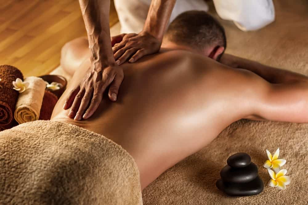 A man having a deep tissue massage on his back.