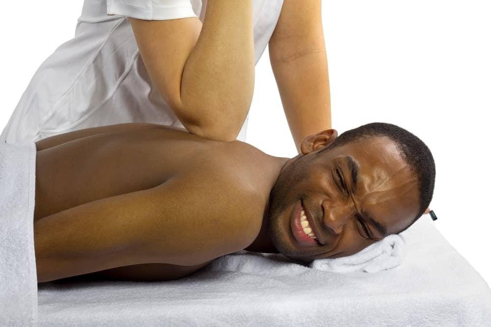 A man having a painful massage.