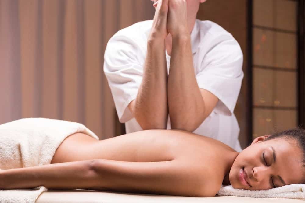Woman having a deep tissue massage.