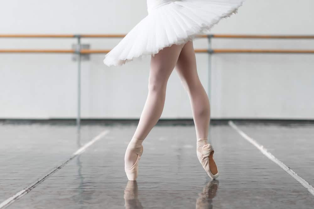 A ballerina on her feet.