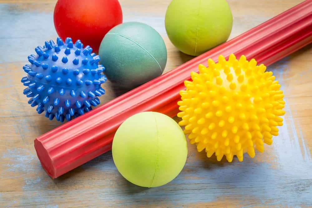 A foam roller and a variety of massage balls.