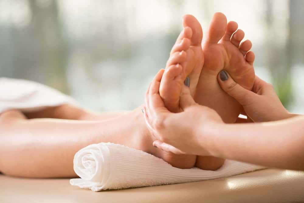 A woman having a reflexology.