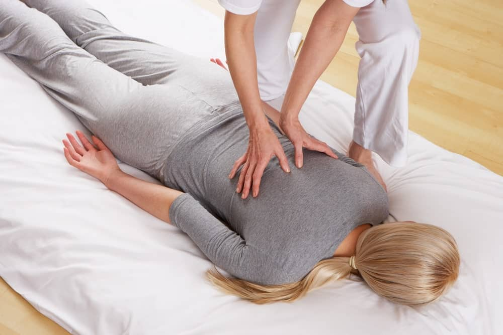 A woman having a shiatsu massage.