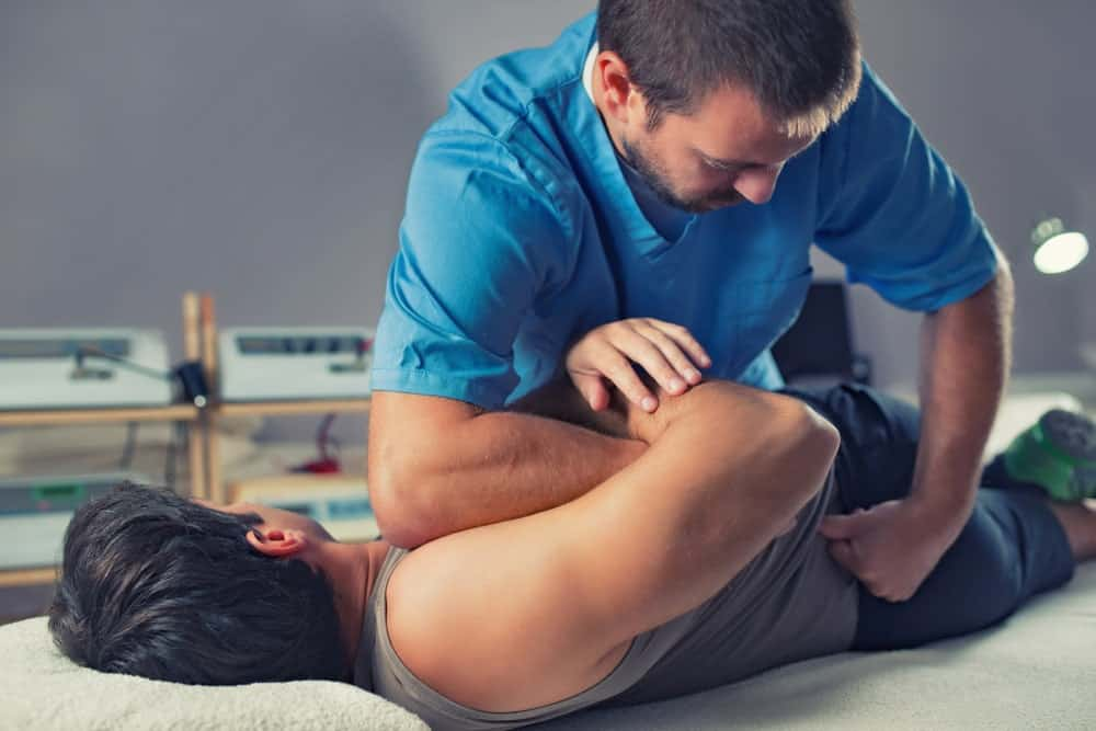 A physiotherapist doing a sports massage.