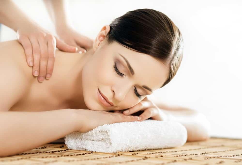 A woman enjoying a traditional Swedish massage therapy.