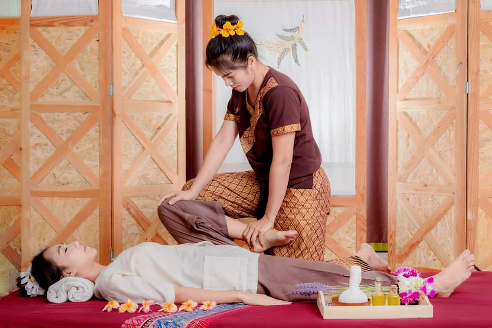 A woman enjoying a Thai massage.