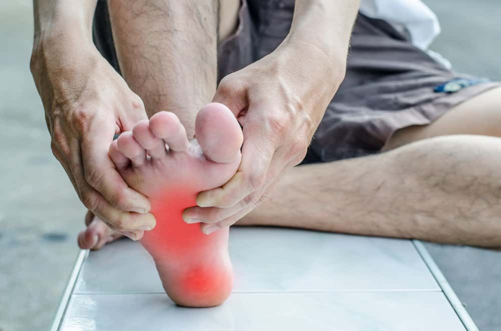 Man's foot suffering from pain and swelling.
