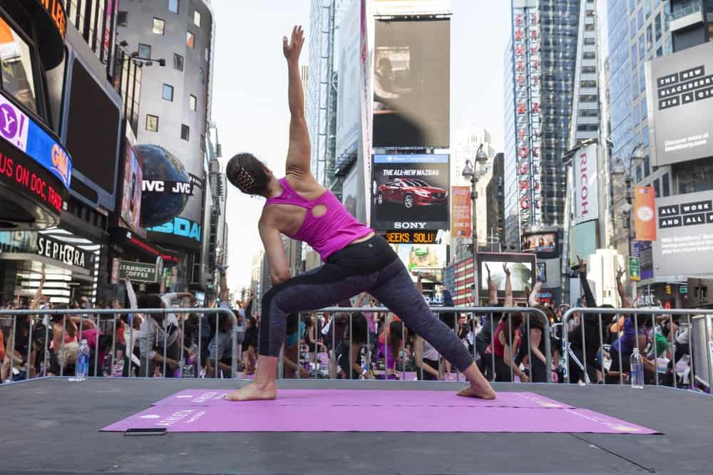 Yoga performance sponsored by Athleta to celebrate solstice on Times Square.