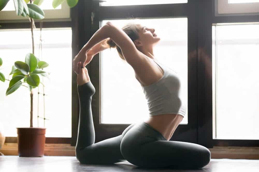 Woman practicing Ashtanga yoga.