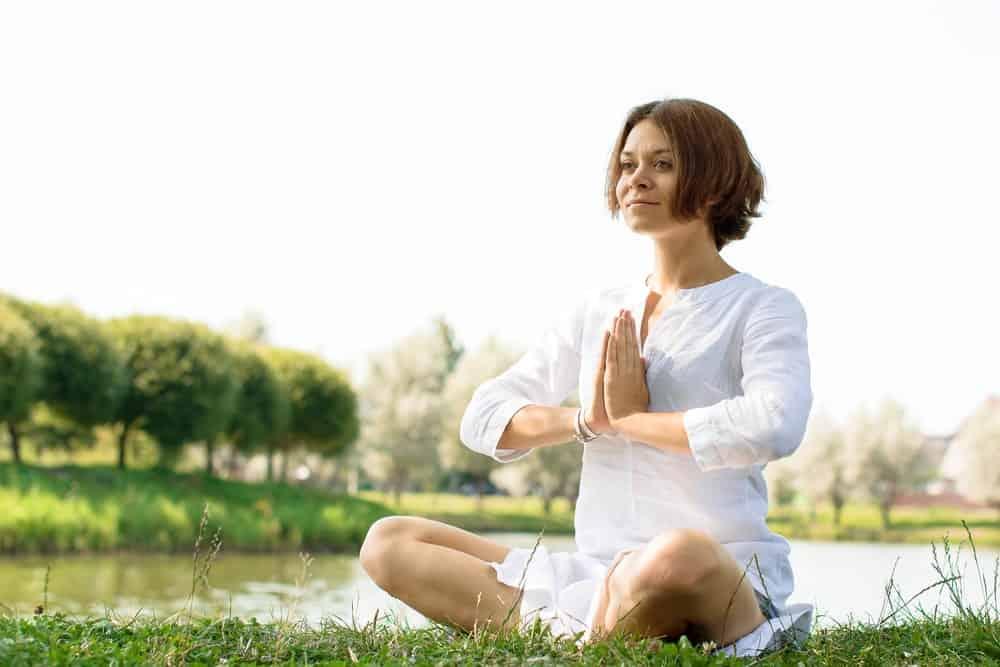 Woman practicing Kundalini yoga.