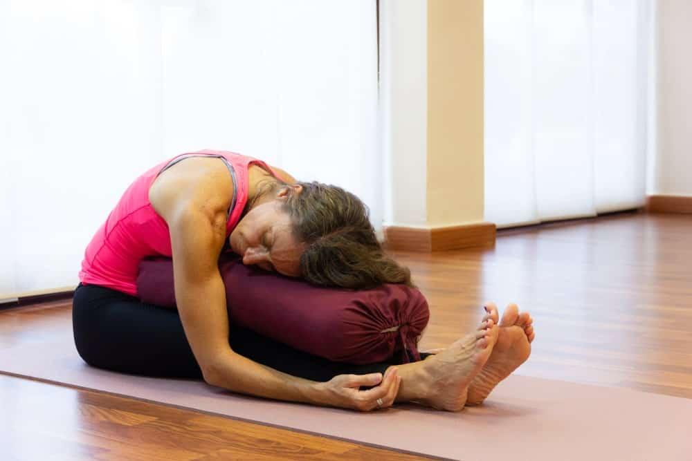 Woman practicing Yin yoga.