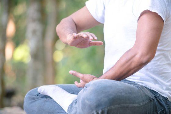 A close look at a man practicing Tai Chi.