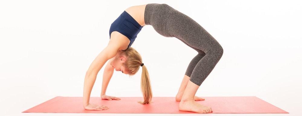 A flexible woman doing the bridge stretch pose.