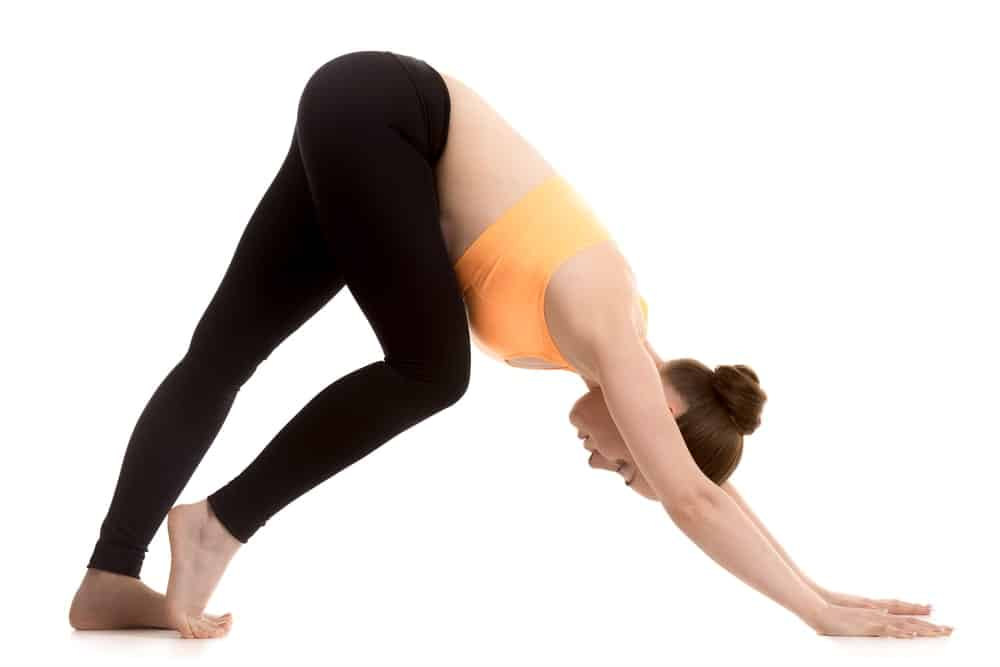 Woman preparing for a downward dog pose.