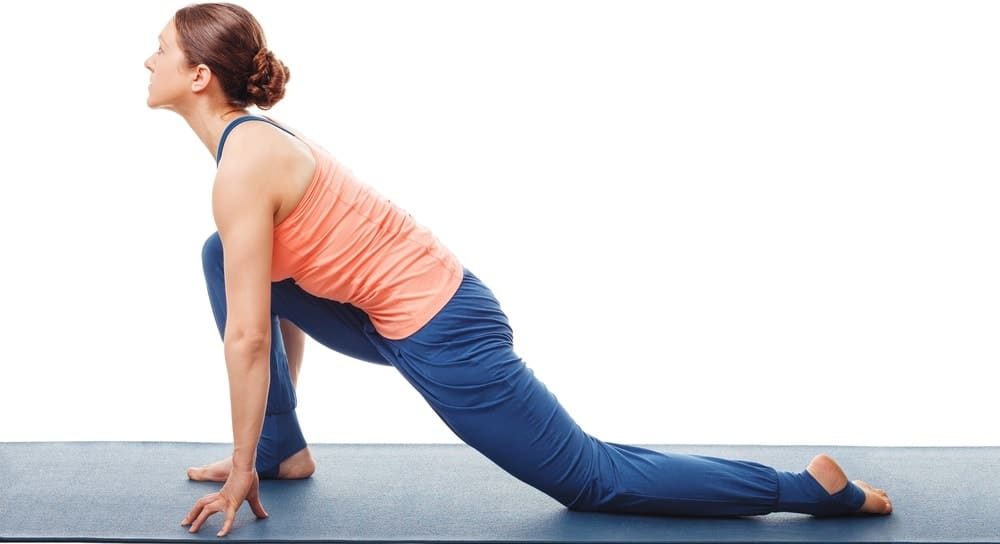 A woman doing the low lunge yoga position.