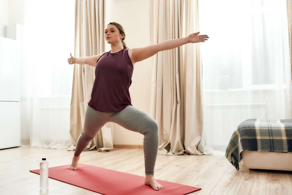 A woman doing the warrior 2 yoga pose.