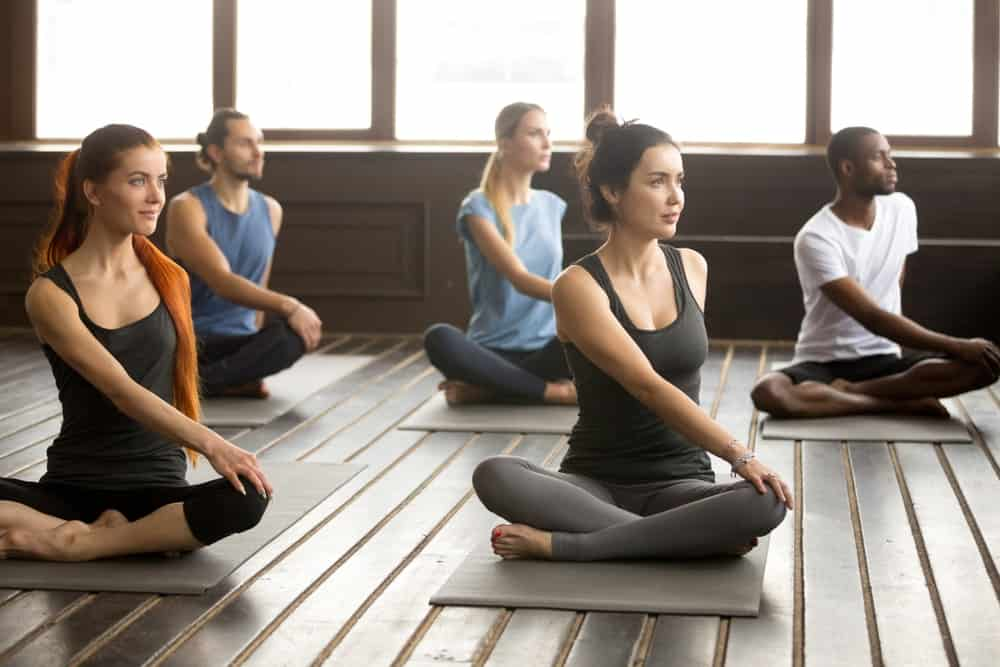 A group of people practicing yoga.