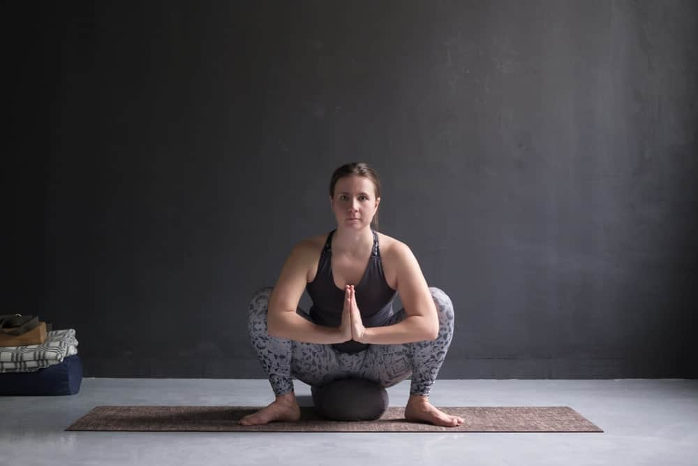 Woman sitting in Malasana pose.