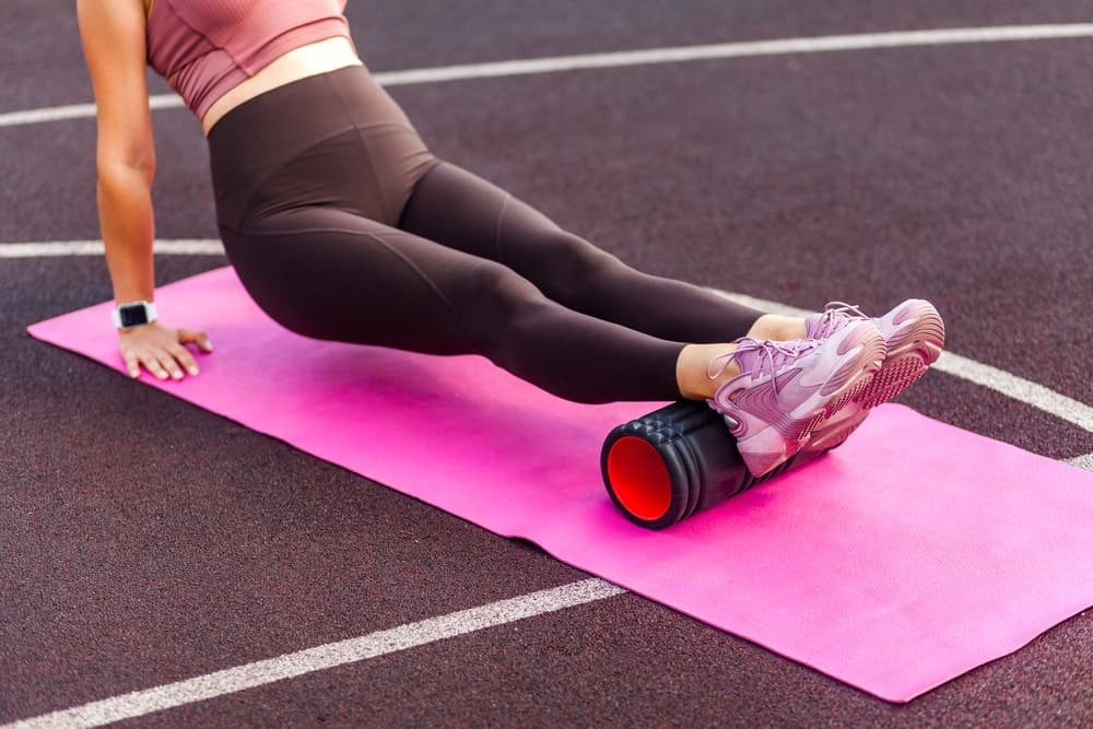 A woman doing the hamstring stretch with ankle roll.