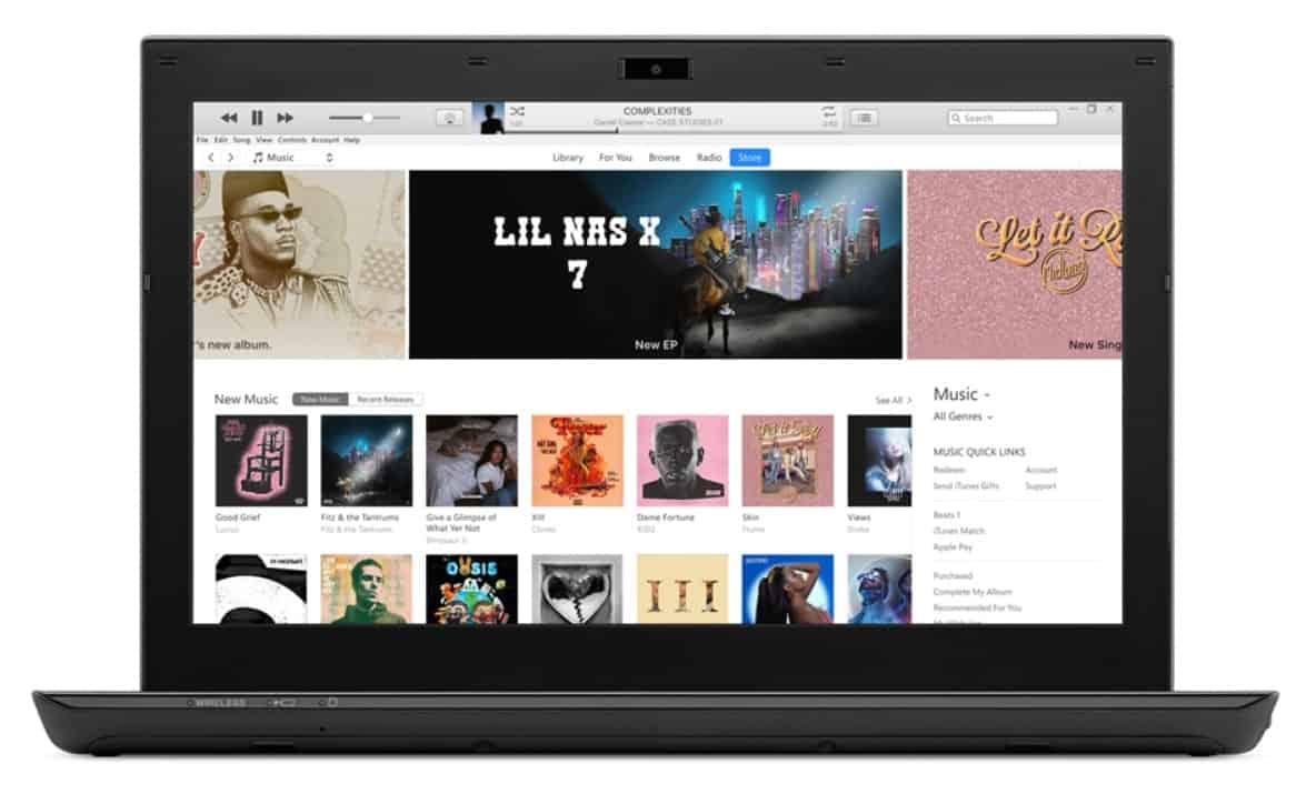 iTunes page on a laptop screen.